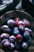 Fresh Blue Plums In Black Plate