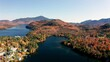 Aerial flythrough over Lake Placid and Mountains during Autumn Fall Colors in Adirondacks, New York, USA