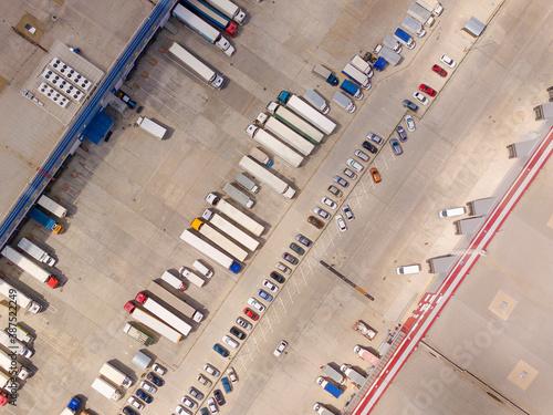 Aerial Shot of Industrial Loading Area where Many Trucks Are Unloading Merchandise Fototapet