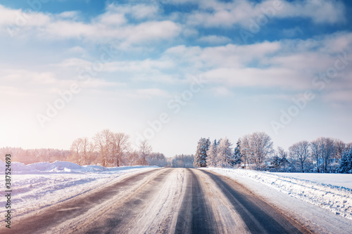 Obraz Winter road with snow and trees all around - fototapety do salonu
