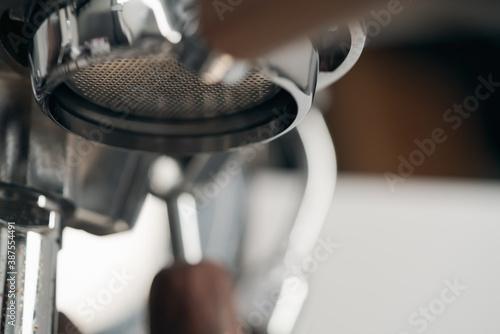 Closeup detail shot of coffee machine with walnut wood handles Fotobehang