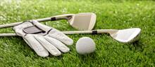Golf Equipment On Green Grass Golf Course, Close Up View.