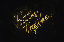 """The Text """"Better Together"""" Is Written With Lamps On A Dark Wall."""