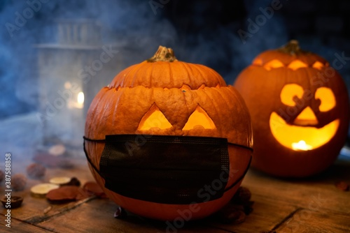 Obraz Scary spooky Halloween pumpkin head jack o lantern in covid-19 virus mask.  - fototapety do salonu