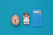 Pack Of Cigarettes And Calcula...