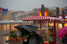 Man With A Broken Umbrella On ...