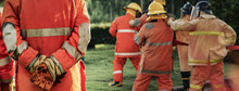 Firefighter Using Extinguisher...
