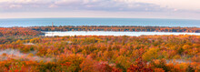 Panoramic View  Of Carpet Of Autumn Trees Around The  Lake Independence, View From Thomas Rock Overlook In Michigan Upper Peninsula.