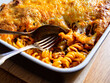 Leinwandbild Motiv Noodle casserole with minced meat, mozzarella cheese and vegetables on wooden table