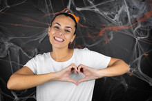 Young Beautiful Woman Over Black Background With Cobwebs And Spiders Smiling In Love Showing Heart Symbol And Shape With Hands