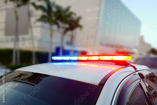 First responder police car cruiser, flashing a full array of blue and red tactic Canvas Print