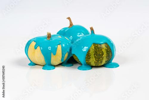 Slika na platnu Some pumpkins with the blue color running down