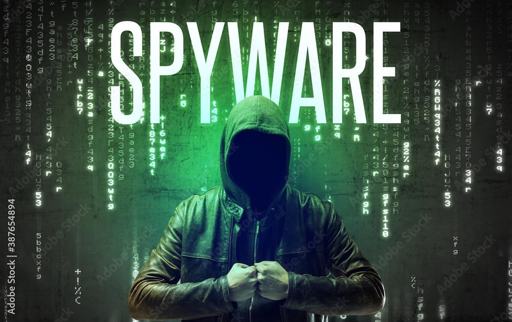 Fototapeta Faceless hacker with SPYWARE inscription, hacking concept