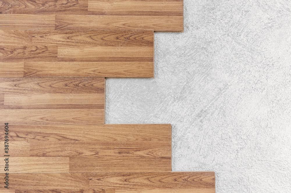 Fototapeta Wooden flooring installation and renovation, with base cement floor - obraz na płótnie