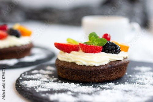 Chocolate cupcakes with cream cheese, fruits and berries Wallpaper Mural