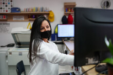 Young Woman With Face Mask Sta...