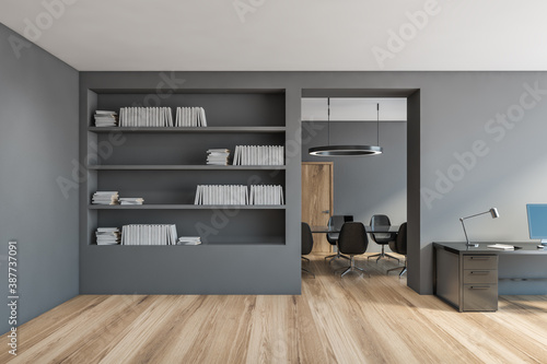 Obraz Office minimalist room, grey bookshelf and open space with wooden floor - fototapety do salonu