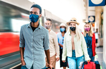Multiracial Crowd Of People Walking At Railway Station Platform - New Normal Travel Concept With Young Travelers Covered By Protective Face Mask - Focus On African American Guy At Left