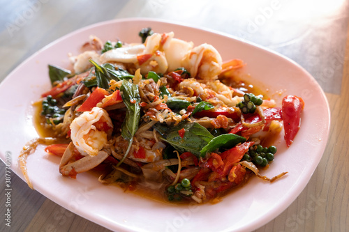 Tela Mixed seafood stir fried with spicy Thai style