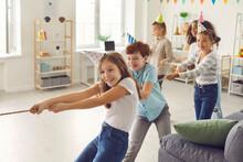 Happy Children Playing Tug-of-...