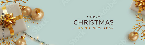 Obraz Christmas banner. Background Xmas design of realistic beige gifts box, golden 3d render snowflake and glitter gold confetti, bauble ball. Horizontal christmas poster, greeting card, header for website - fototapety do salonu
