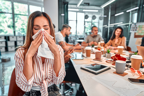 Fotografia Flu-sick girl sneezing in tissue, ill woman coughing suffering fever