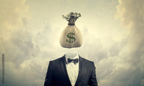 Photo Greed concept. Businessman with bag of money for a head