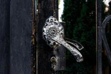 Black Vintage Door Handle On Wrought Iron Door