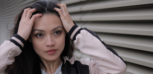 Pretty Asian girl in a city - close up shot - people photography