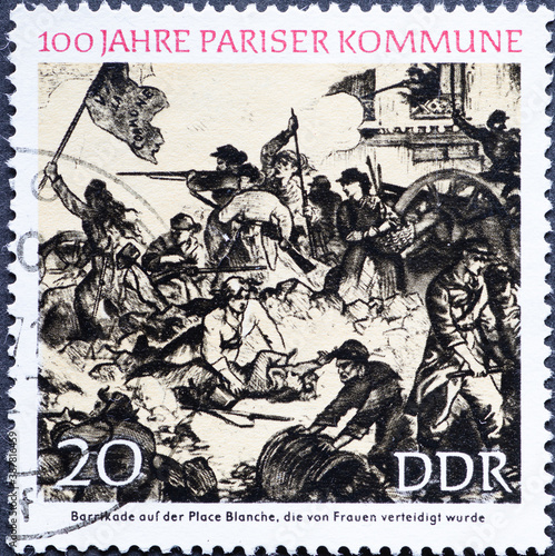 GERMANY, DDR - CIRCA 1971: a postage stamp from Germany, GDR showing 100 years of the Paris Commune, 100 years of the Paris Commune, barricade defended by women on Place Blanche © zabanski