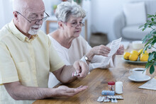 Husband Taking His Medicines A...