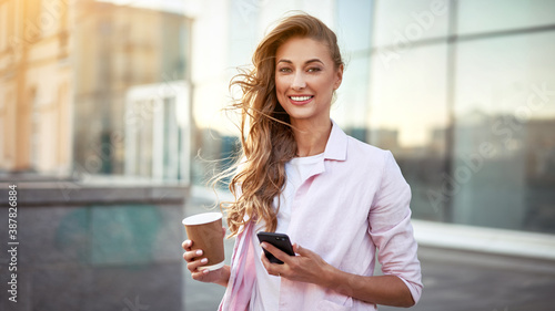 Leinwand Poster Businesswoman standing summer day near corporate building  Business person