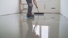 Filling The Floor. A Contractor Painter Will Paint The Garage Floor To Speed Up The Sale Of Your Home. Fill In The Low Spots With Self-leveling Compound For A Fine Leveling.