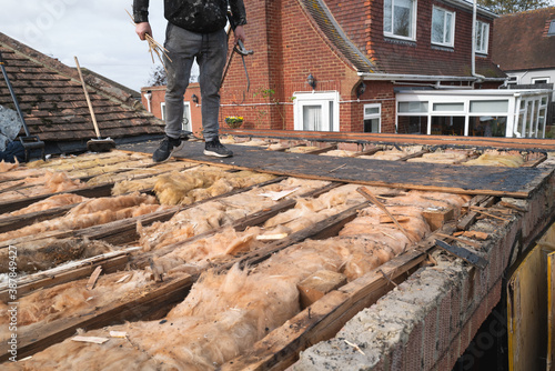 Fotografie, Tablou Broken beams exposed on an old flat roof extension after the old roof had been removed prior to a new flat felt roof being installed