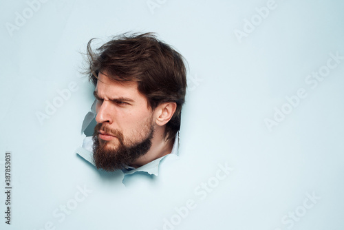 A bearded man peeps out from behind the wall dissatisfaction emotions office off Canvas Print