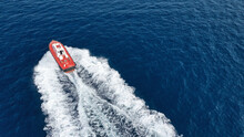 Aerial Drone Photo Of Pilot Boat Cruising In High Speed In Deep Blue Open Ocean Sea Near Commercial Port