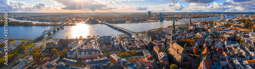 Fototapety, obrazy: Epic panoramic Riga view from above. Aerial view of the old town of Riga, Latvia. Beautiful after storm clouds, wet weather and sunny clouds.