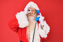 Old Senior Man Wearing Santa Claus Costume Using Vintage Telephone Smiling Happy Doing Ok Sign With Hand On Eye Looking Through Fingers