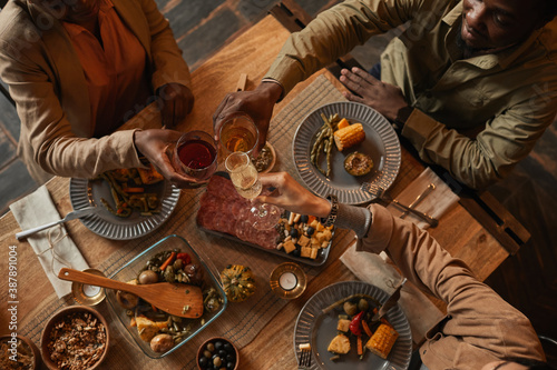Fotografia, Obraz Top view background of multi-ethnic group of people enjoying feast during dinner