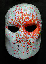White Ice Rink Raider Mask With Blood Splattered Isolated Against Black Background