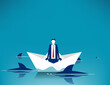 Businessman sitting on paper boat surrounded by sharks