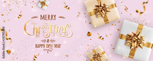 Obraz Gold Christmas and New Year Text on pink Xmas background with gift boxes, fir branches, gold ribbon, decoration, sparkles, confetti, bokeh. Merry Christmas card. Vector Illustration, realistic vector - fototapety do salonu