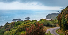Panoramic View From Above At Knight's Point Lookout With Fog In The Distance And Sea Stacks Along The Shore Near Bruce Bay On The West Coast Of New Zealand, South Island.