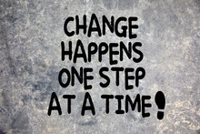 Change Happens One Step At At Time Quote Written On Stone Background In Nature. Development, Success And Improvement