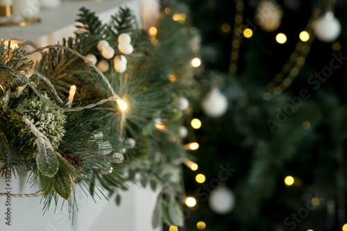 Christmas tree on a gray background. garland, white balls Canvas