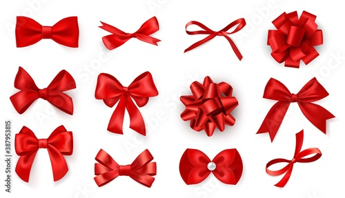 Obraz Realistic bow set. Red silk ribbons with bows festive decor satin rose, luxury elements for holiday packaging and design, elegant gift tape 3d vector decor set on white background - fototapety do salonu