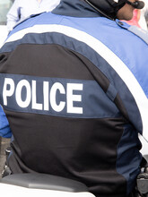 Back View Of French Policeman Police Motorbike In France