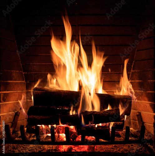Fotomural Fireplace burning wood logs, cozy warm home christmas time