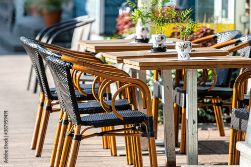 sidewalk open air cafe with empty chairs and  tables Canvas