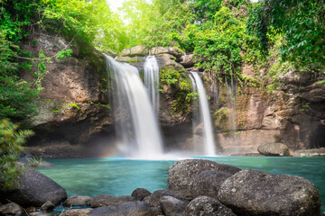 Travel to the beautiful waterfall in deep forest, soft water of the stream in the natural park at Haew Suwat Waterfall at Khao Yai National Park, Thailand